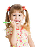 Cute kid girl brushing teeth isolated on white Stock Photos