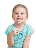 Cute kid girl cleaning teeth isolated on white background Royalty Free Stock Images