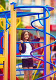 Cute kid, girl climbs on the stile at playground Royalty Free Stock Image