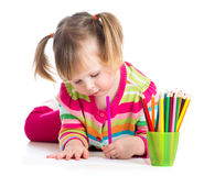 Cute kid girl drawing with colourful pencils Royalty Free Stock Photography