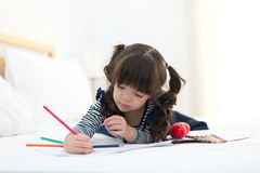 Cute kid girl drawing a picture royalty free stock photo