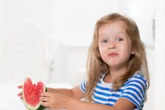 Cute kid girl eating watermelon Royalty Free Stock Images