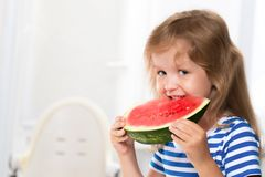 Cute kid girl eating watermelon Stock Photos