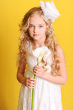 Cute kid girl holding flower Royalty Free Stock Photography