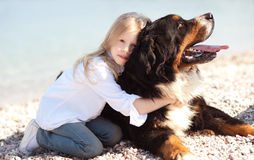 Cute kid girl holding pet outdoors Royalty Free Stock Images