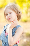 Cute kid girl on nature background. Cute little girl posing on nature background Stock Photos