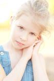 Cute kid girl on nature background. Cute little girl posing on nature background Stock Images