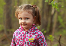 Cute kid girl outdoor in green summer park Royalty Free Stock Image