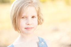 Cute kid girl outdoors. Closeup portrait of cute kid girl outdoors Royalty Free Stock Images