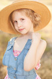 Cute kid girl outdoors. Smiling little girl posing outdoors Stock Photo