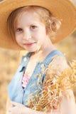 Cute kid girl outdoors. Smiling little girl posing outdoors Stock Photos