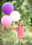 Cute kid girl playing with balloons Royalty Free Stock Photography