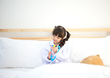 Cute kid girl playing doctor with plush toy Stock Photography