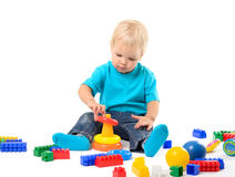 Cute kid girl playing with educational toy Stock Images