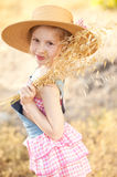 Cute kid girl playing outdoors. Portrait of smiling kid girl playing in meadow outdoors Stock Image