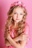 Cute kid girl posing on pink Stock Image