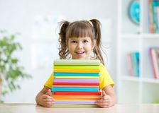Cute kid girl preschooler with books Stock Photography