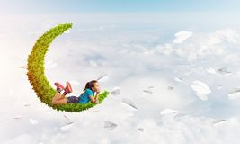 Concept of careless happy childhood with girl dreaming about something Stock Images