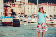Cute kid girl walking on coastline in Piran, Slovenia on summer vacation Royalty Free Stock Photos