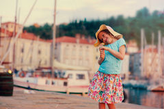 Cute kid girl walking on coastline in Piran, Slovenia on summer vacation Stock Photo