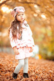 Cute kid girl wearing autumn clothes outdoors Royalty Free Stock Photo