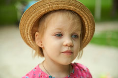 Cute kid girl wearing hat outdoors Royalty Free Stock Image