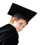 Cute kid graduate with graduation cap Stock Photos