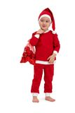 Cute kid grimacing in santa costume Stock Photography