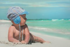 Cute kid. Happy cute kid on the beach looking at the sea Stock Photos