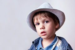 Cute kid with hat and jeans. Cute kid with big eyes in hat and jeans Stock Photo