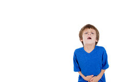 A cute kid having stomach ache Royalty Free Stock Photos