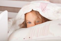 Cute kid Hiding Under The Blanket Royalty Free Stock Photo
