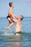 Cute kid and his dad in holiday Stock Photos
