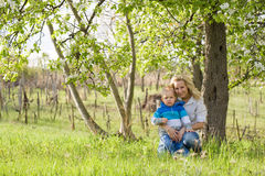 Cute kid with his mom outdoors in nature. Cute kid with his mom outdoors in nature at spring Royalty Free Stock Photos