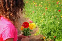Cute kid holding bouquet of spring flowers Royalty Free Stock Images