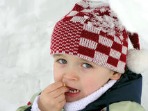 Cute kid in Iglu. Hlapce portrait photography in the winter in an igloo Stock Image