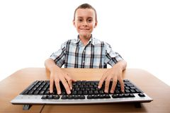 Cute kid at the keyboard Royalty Free Stock Image
