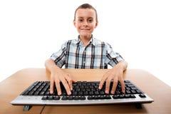 Cute kid at the keyboard Royalty Free Stock Image