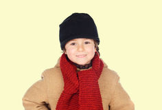 Cute kid with knitted red color scarf Royalty Free Stock Images