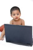 Cute kid with lap top. Cute Indian kid playing with Lap top Stock Photography