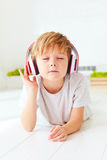 Cute kid listen to the music, relaxing at home. Cute kid, boy listen to the music, relaxing at home Stock Images