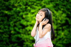 Cute kid listening to music on headphones Stock Photography
