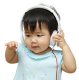 Cute kid listening to music on headphones and enjoying Royalty Free Stock Image