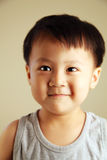 Cute kid looking away. Cute child looking away to the side with a smile Stock Images