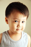 Cute kid looking away. Cute child looking away to the side with a smile Stock Photo