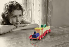 Cute kid looking at old wooden train. selective color style, and selective focus. insparation and chilhood concept Royalty Free Stock Images
