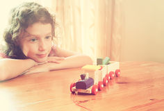 Cute kid looking at old wooden train. selective focus. insparation and chilhood concept.  Stock Images
