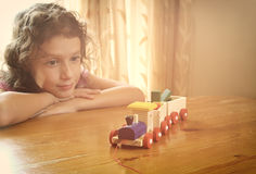 Cute kid looking at old wooden train. selective focus. inspiration and childhood concept Stock Image
