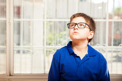 Cute kid looking up at home Stock Photography
