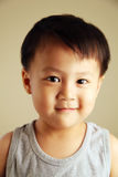 Cute kid looking at viewer. Cute child looking at viewer with a smile Royalty Free Stock Image